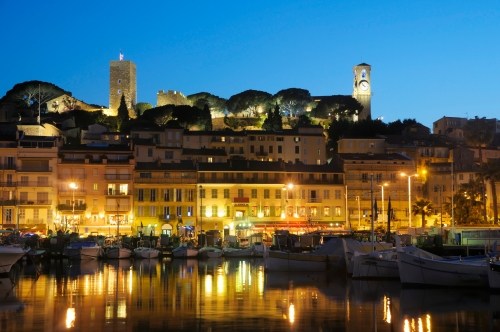 Cannes by night reflected in the water